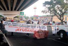 Photo of Con bloqueo de autopista ex trabajadores del ayuntamiento de Cuernavaca exigen su reinstalación